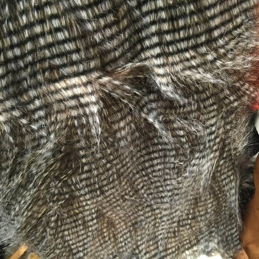 furry throw in gray, beige and black