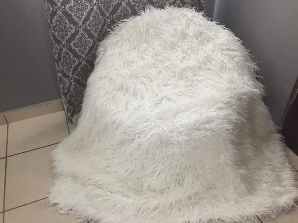 white throw extended over a beanbag