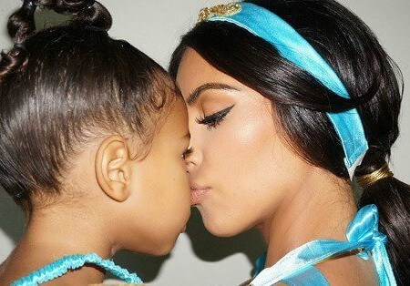 Kim Kardashian kissing her daughter North West on her nose